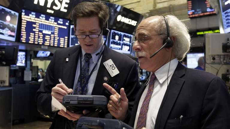 Traders Christopher Forbes, left, and Peter Tuchman work