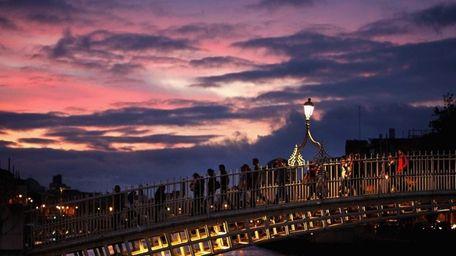 People make their way across a bridge over