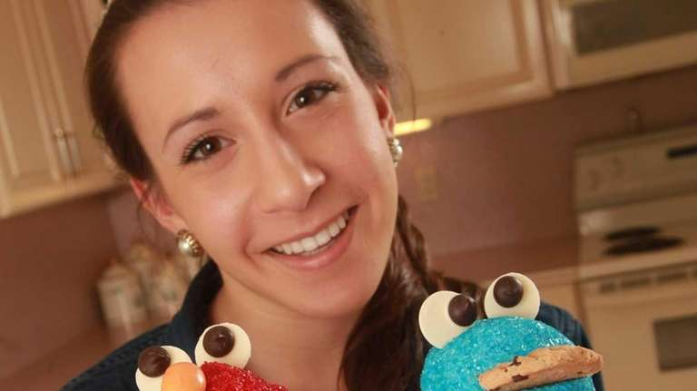 Finished Elmo and Cookie Monster cupcakes made by