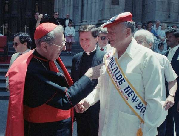John Cardinal O'Connor and Mayor Edward Koch turn