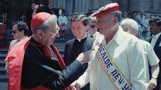 John Cardinal O'Connor and Mayor Edward Koch turn