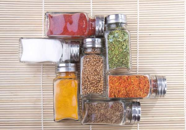 Square, glass spice bottles stack easily.