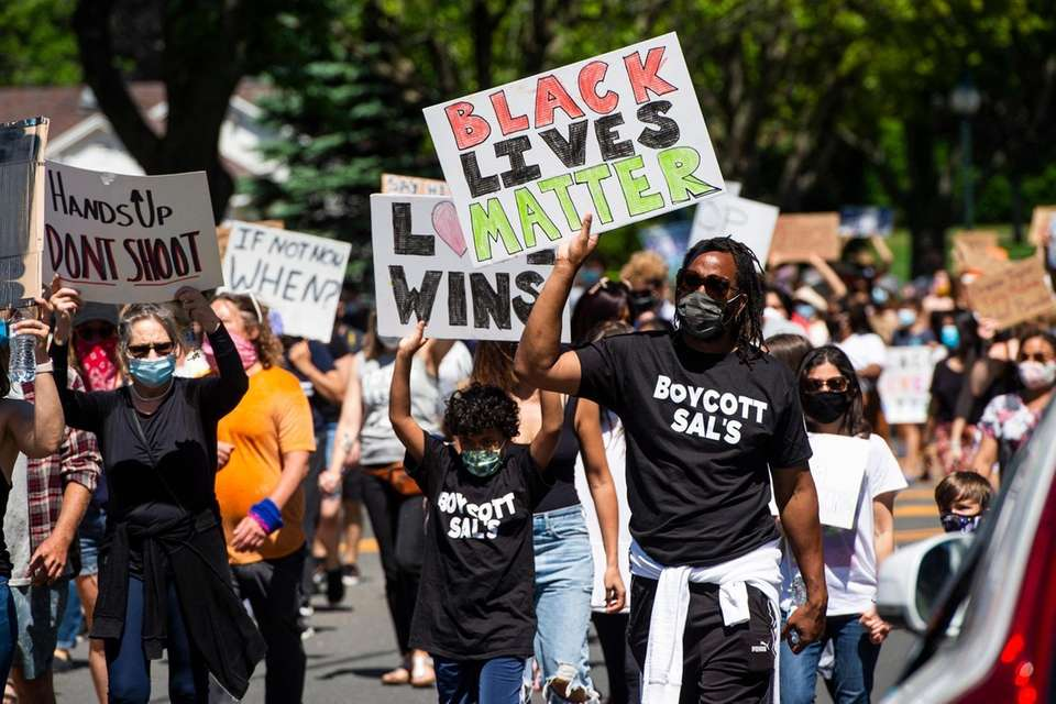 Rashid Johnson, right, from NYC, participates in a