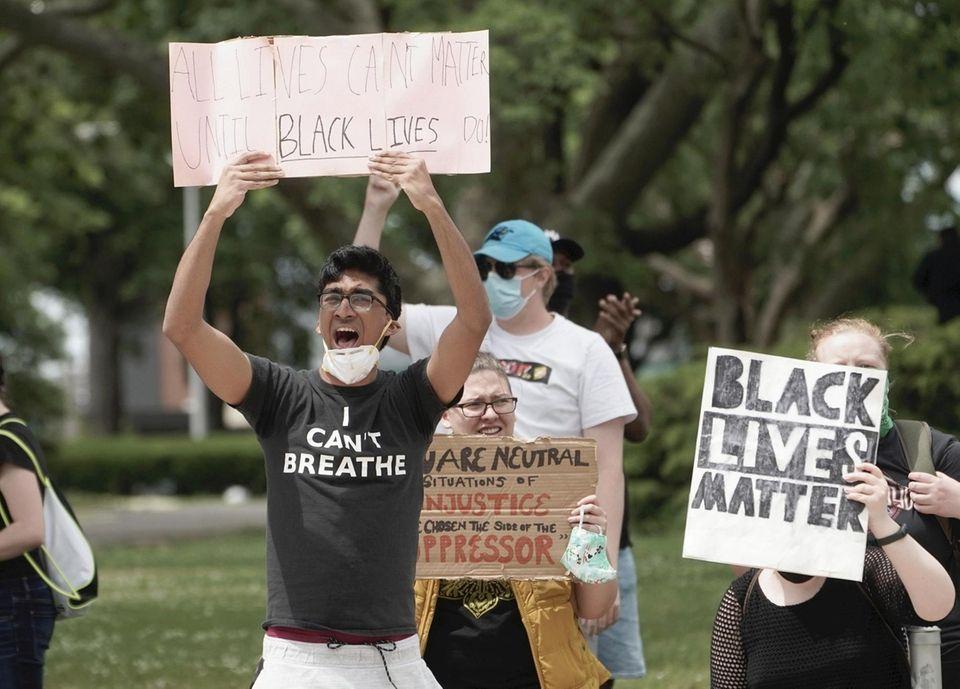 Protestor chants Black Lives Matter in Caravan for