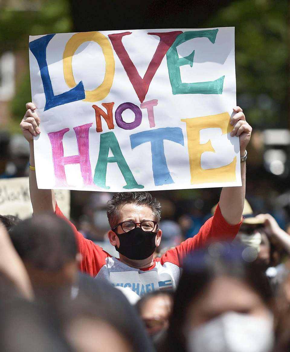 Hundreds of anti-racism protesters gather for a peaceful