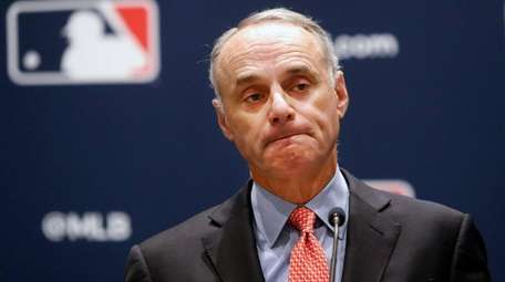 Major League Baseball commissioner Rob Manfred pauses while