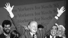 New York Mayor Ed Koch raises his arms