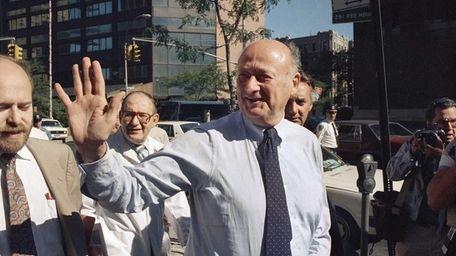 New York Mayor Edward I. Koch greets onlookers