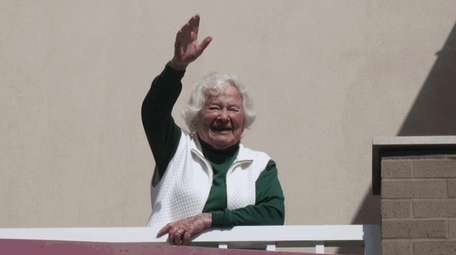 The writer's mother, Vivian Schachter, waves to her