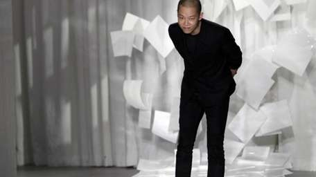 Designer Jason Wu takes a bow after presenting