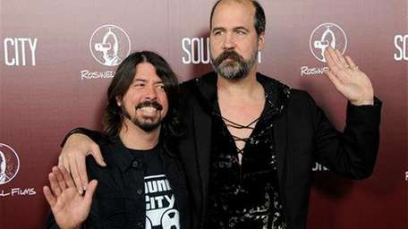 Dave Grohl, left, former drummer of Nirvana and