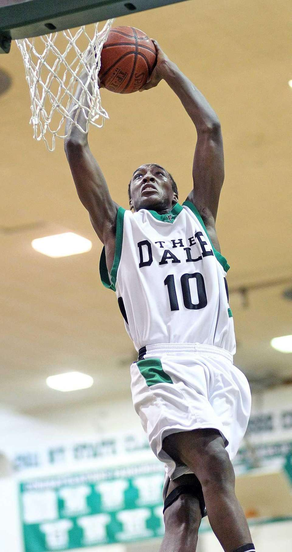 Farmingdale's Curtis Jenkins slam dunks the ball during