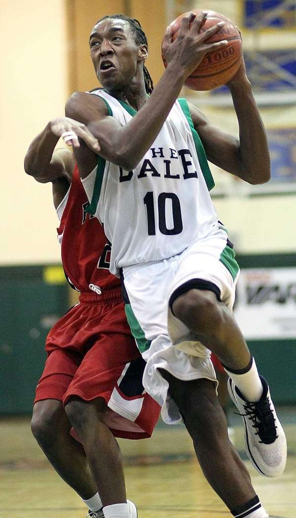 Farmingdale's Curtis Jenkins drives past Freeport's Shawnee Barrett.