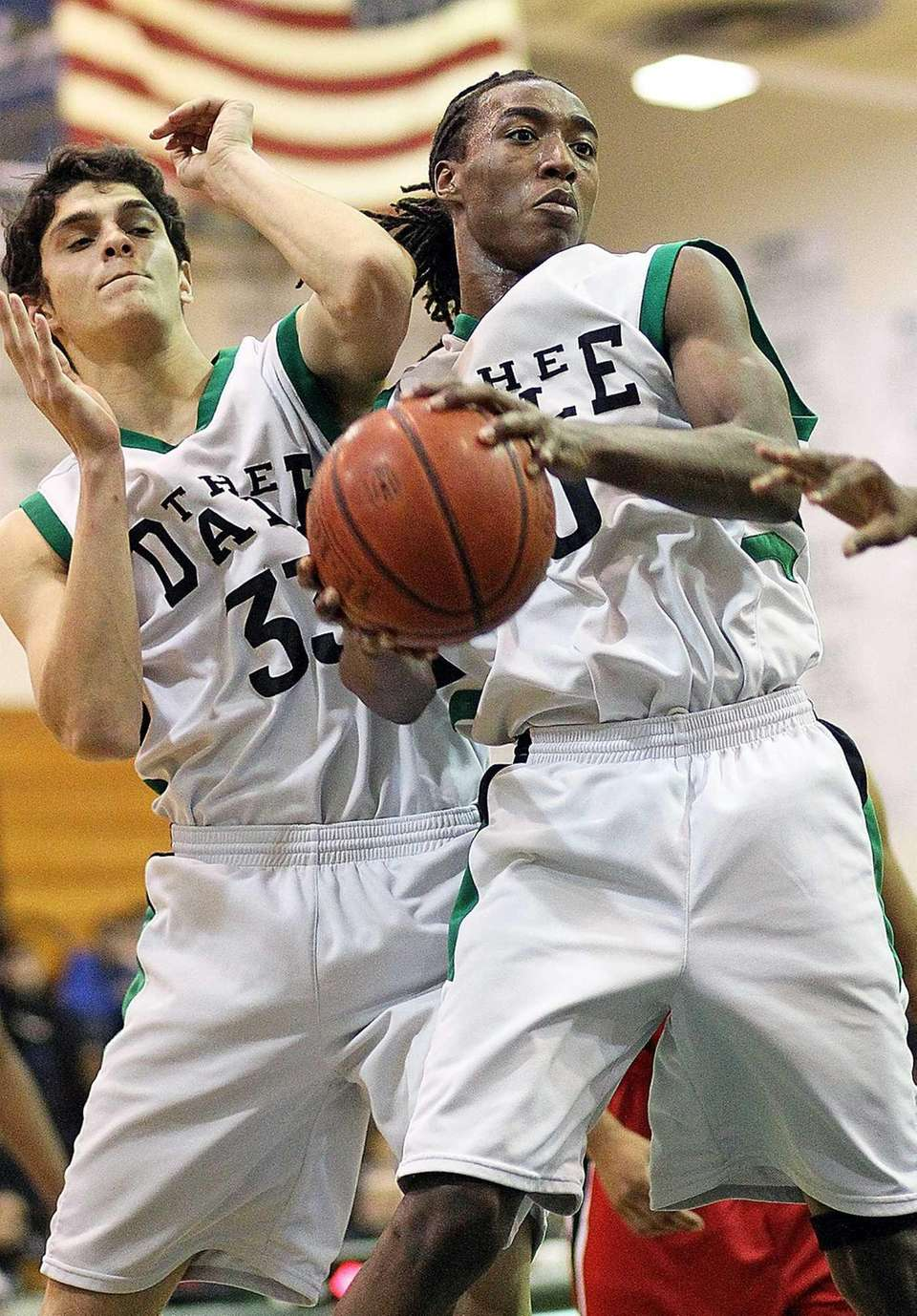 Farmingdale's Curtis Jenkins gets the rebound in front