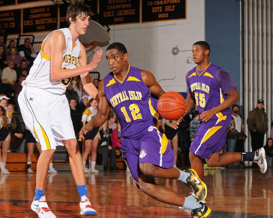 Central Islip's Timothy McKenzie, center, gets pressured by
