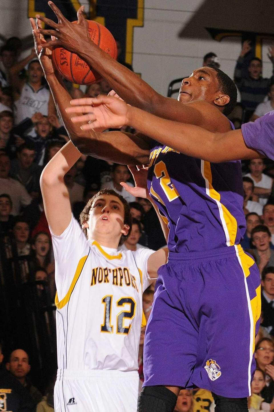 Central Islip's Timothy McKenzie, right, grabs a rebound