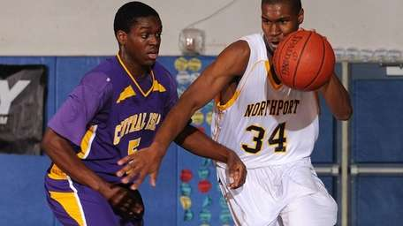 Northport's Michael Milligan, Jr., right, looks to dribble
