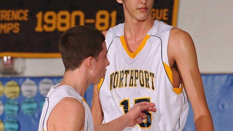 Northport's Luke Petrasek, right, gets a congratulatory pat
