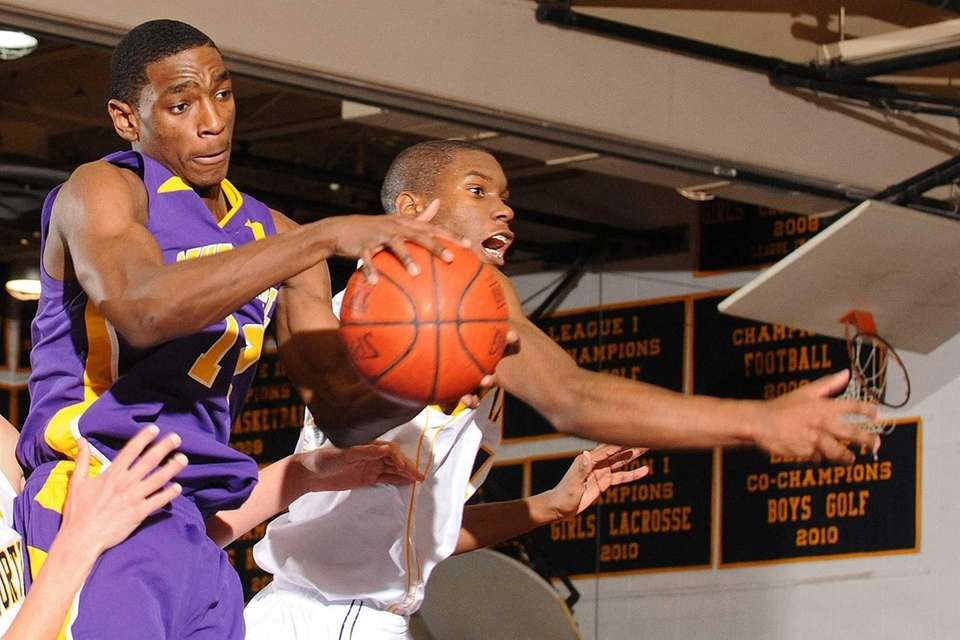 Central Islip's Timothy McKenzie, left, cuts in front