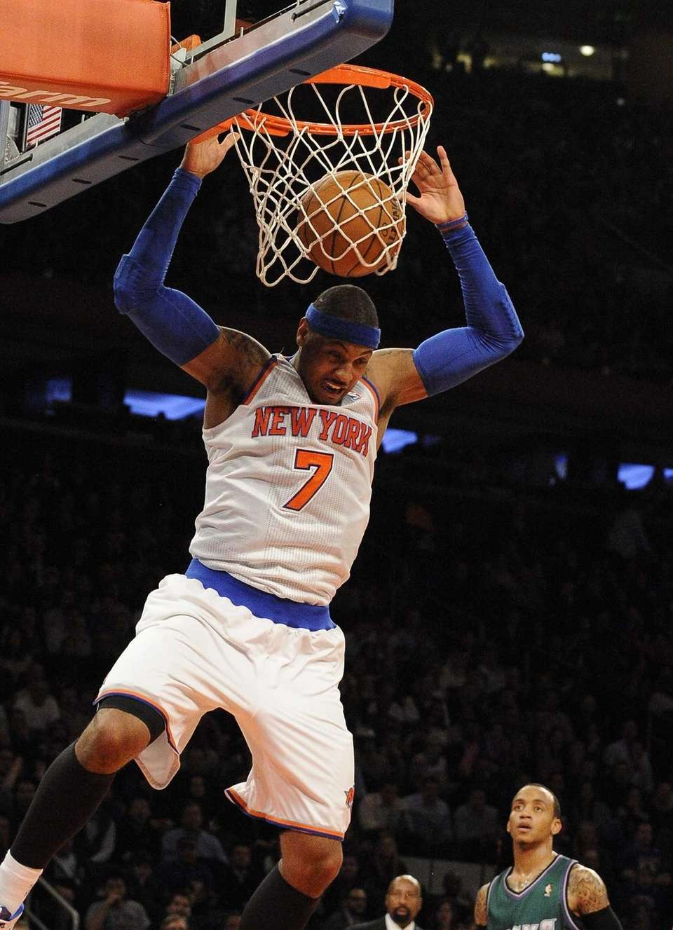 Carmelo Anthony dunks the ball during a game