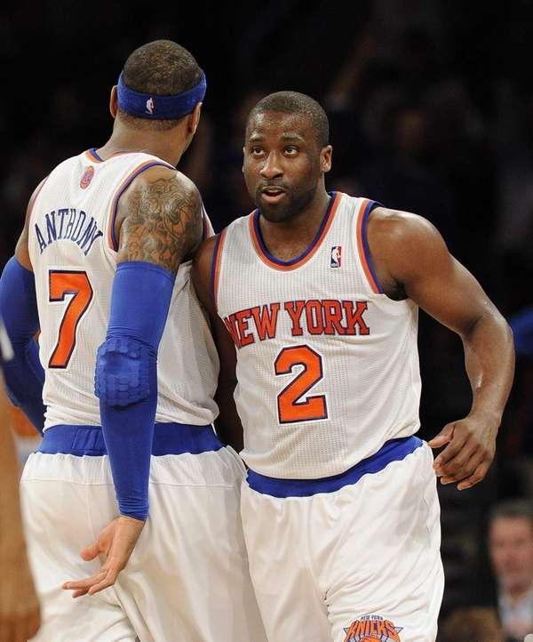 Raymond Felton celebrates his basket with Carmelo Anthony