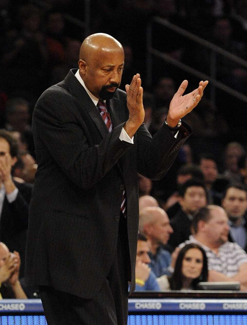 Mike Woodson claps for his team during a
