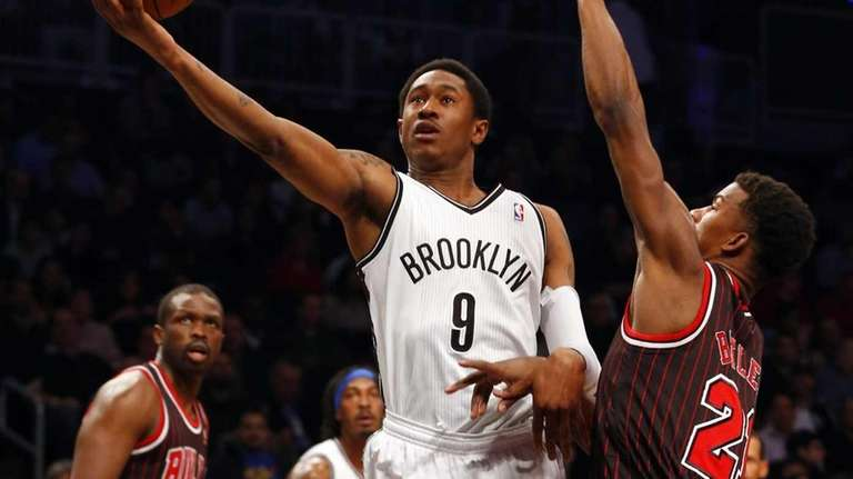 MarShon Brooks goes to the hoop for a