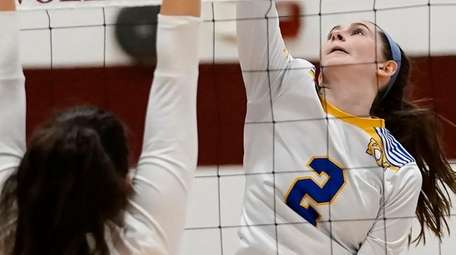Kellenberg's Emily Acimovic, No. 2, with the spike
