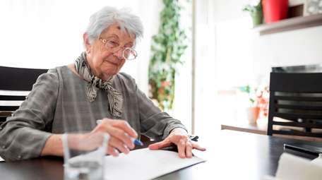 A woman completes a self-assessment for dementia.
