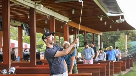 Southampton resident Kent Hunter works on his swing