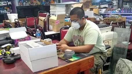 Kush Singhal sorts collectible cards from a new