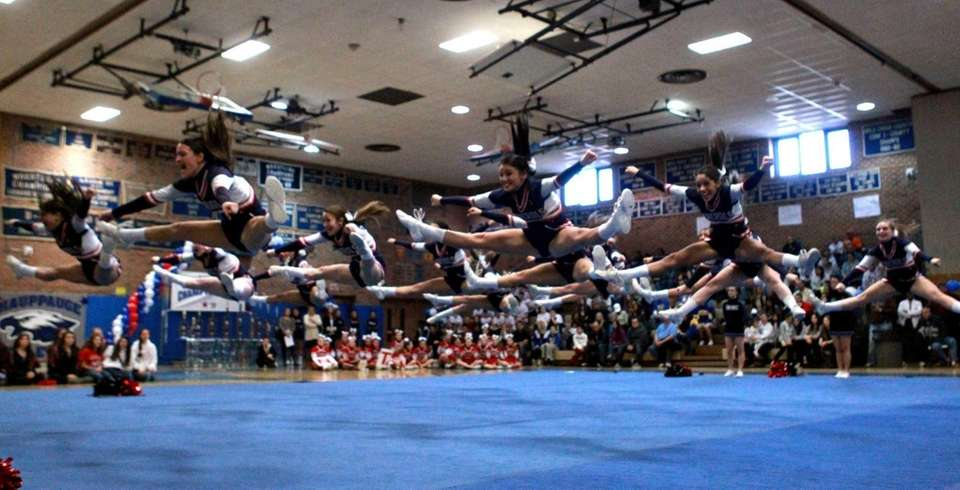The MacArthur High School medium varsity squad leap