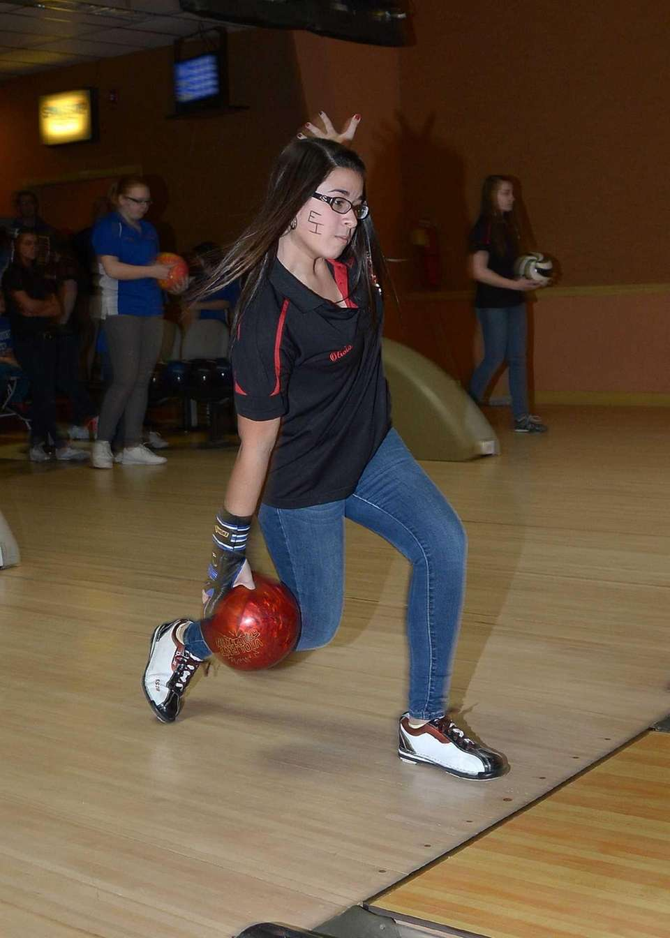 East Islip's Olivia Lopera on the approach, just