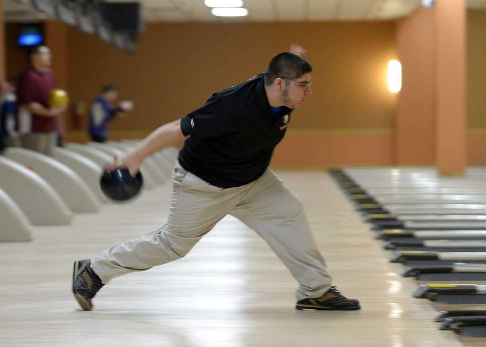 East Islip's Mike Kissel releases the ball during