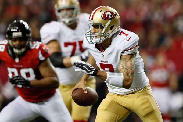 San Francisco 49ers quarterback Colin Kaepernick runs with
