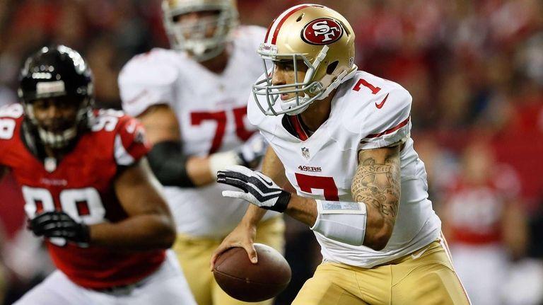 San Francisco 49ers quarterback Colin Kaepernick runs with