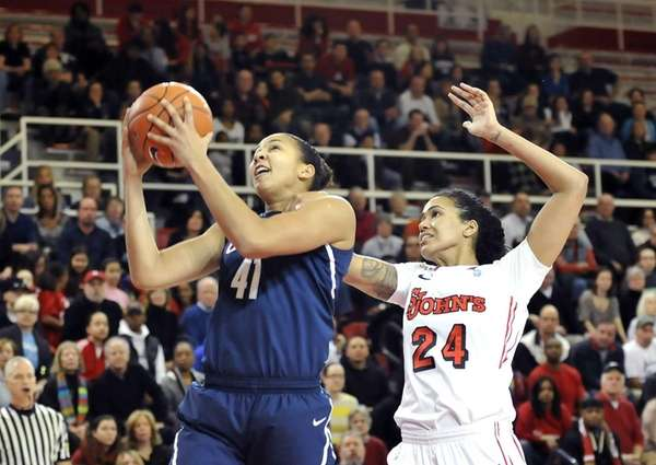 Kiah Stokes of UConn drives to the basket