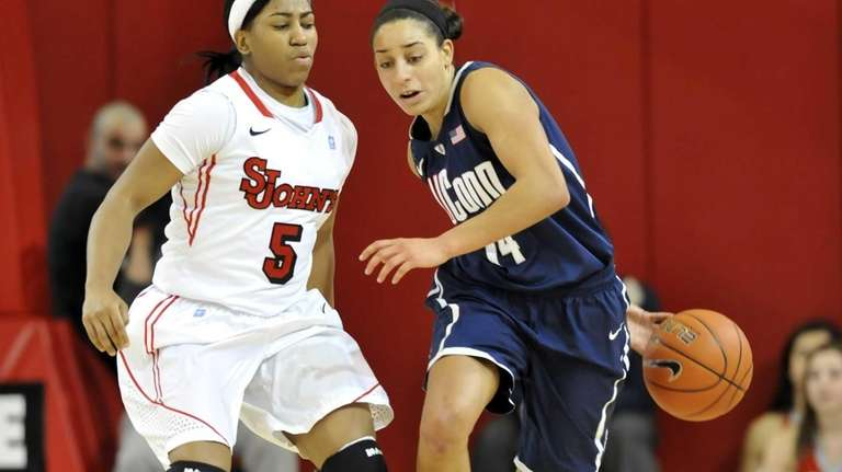 Bria Hartley of UConn dribbles the ball behind