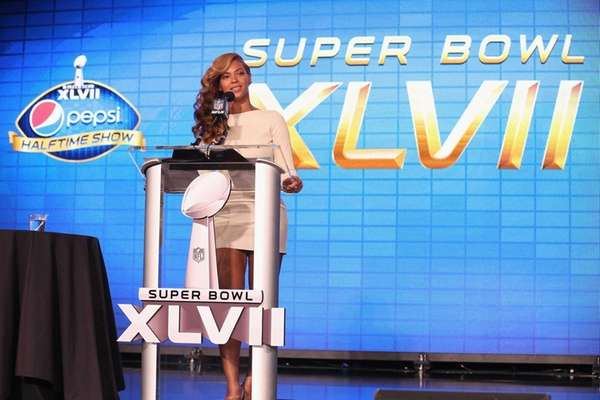 Beyonce speaks onstage at the Pepsi Super Bowl