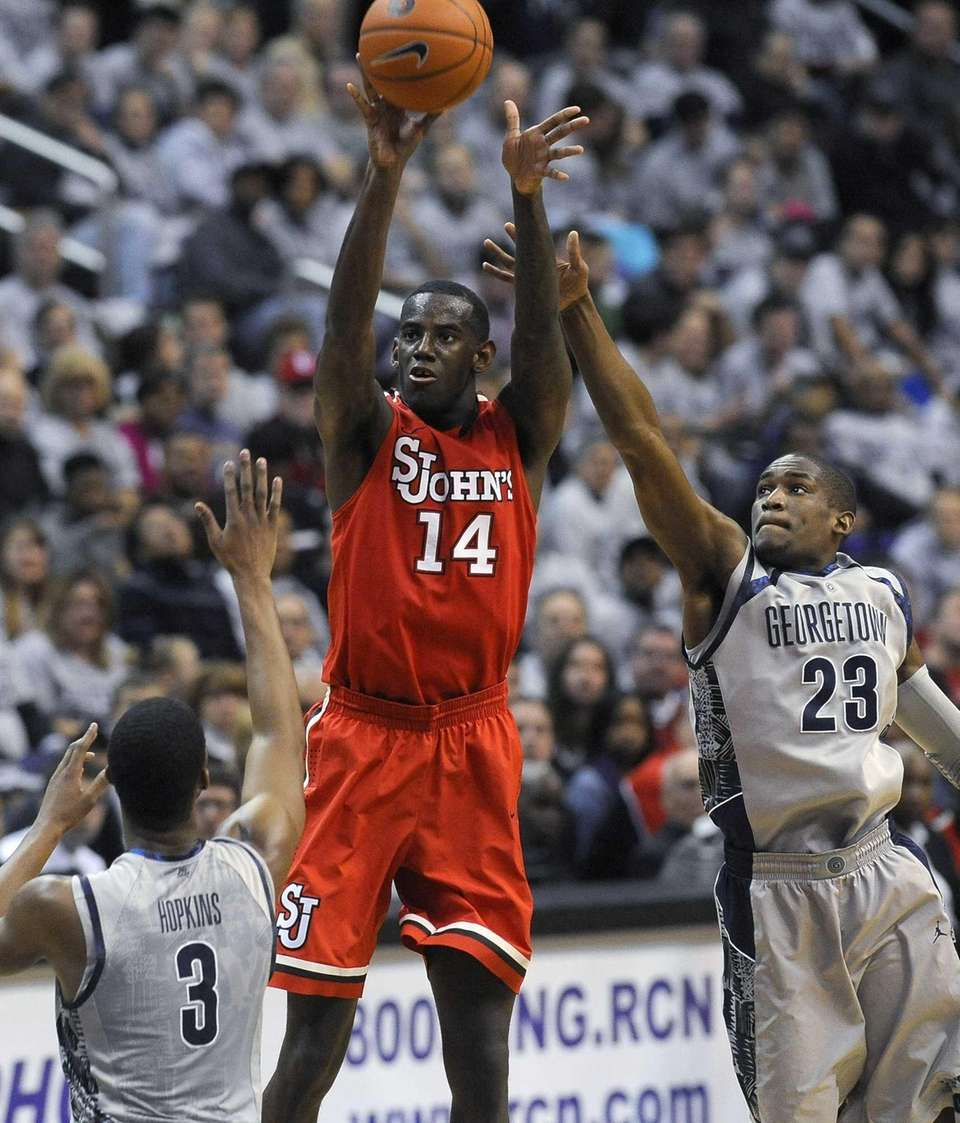 St. John's forward JaKarr Sampson (14) goes up