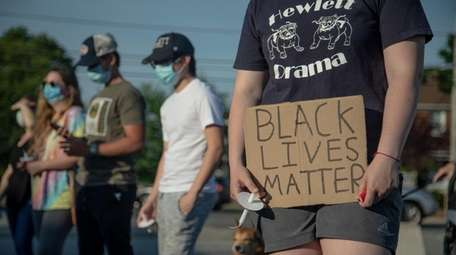 Demonstrators hold a vigil for the black and