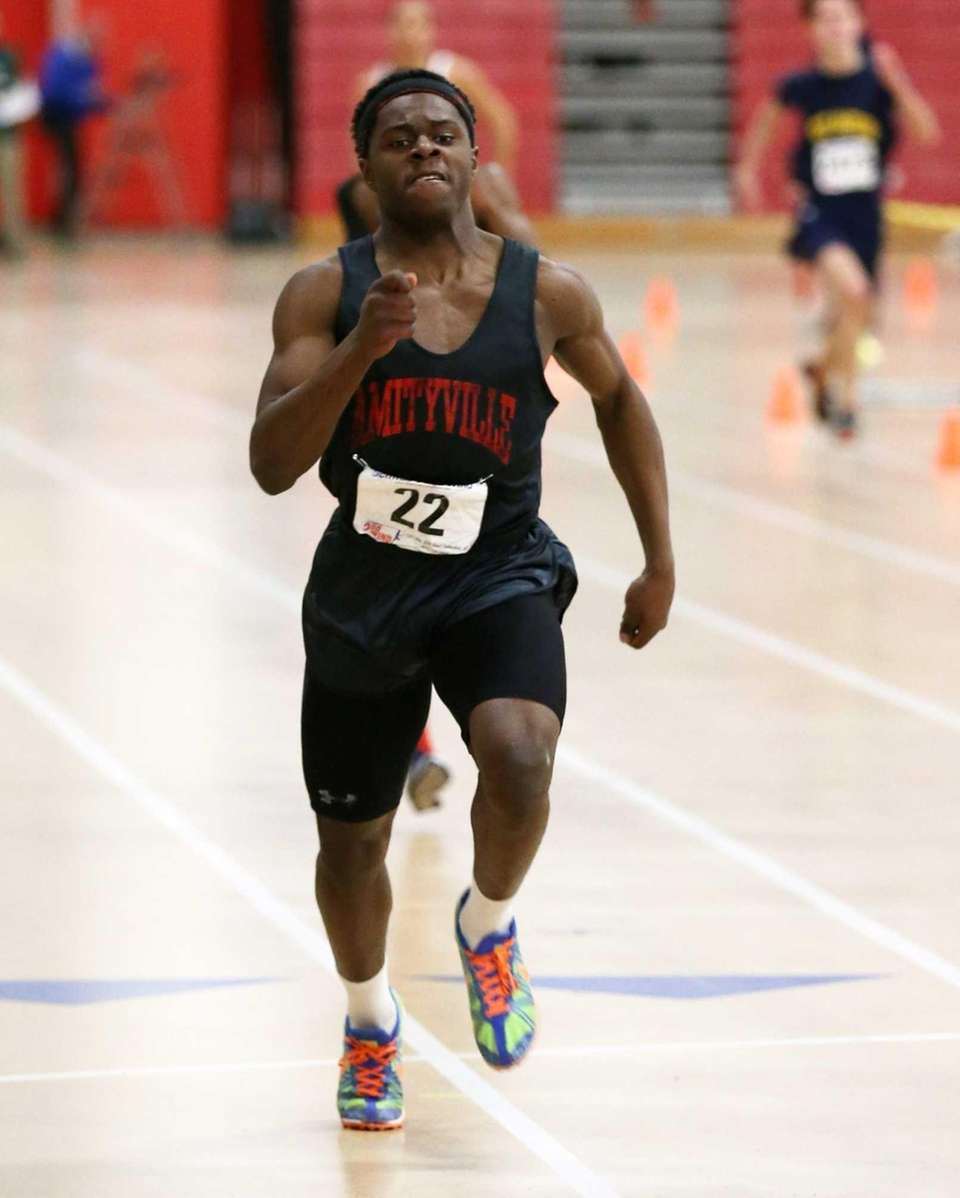 Amityville's Vincent Jackson wins the 300-meter dash in