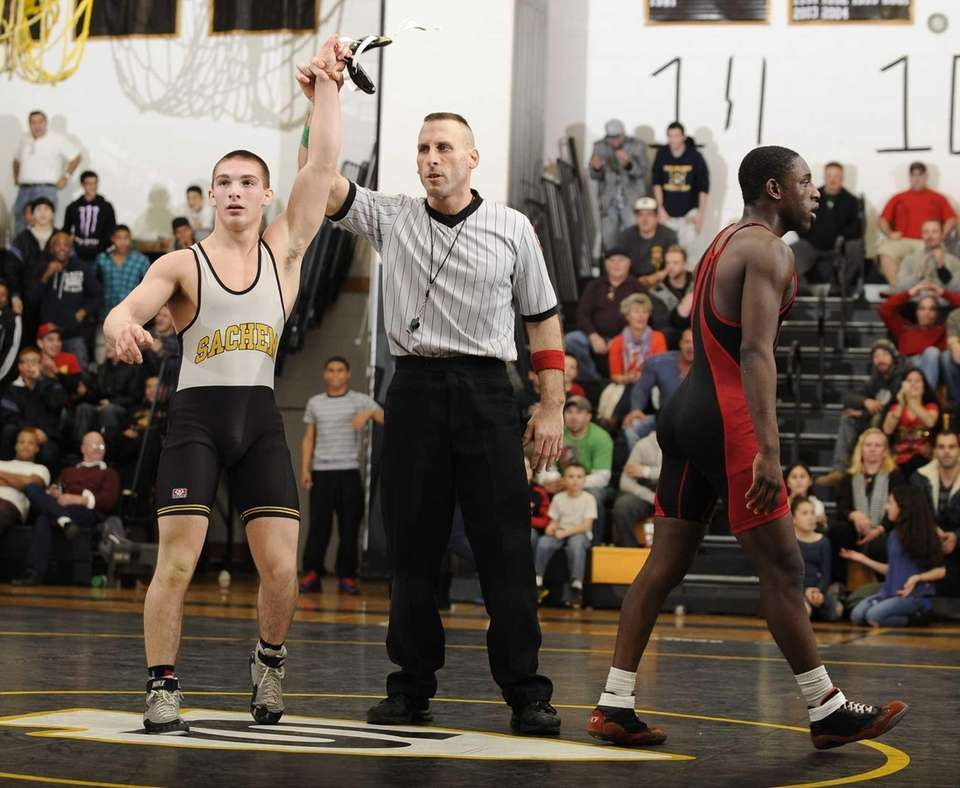 Sachem North's Matt Marino defeats Connetquot's Greg Cherry