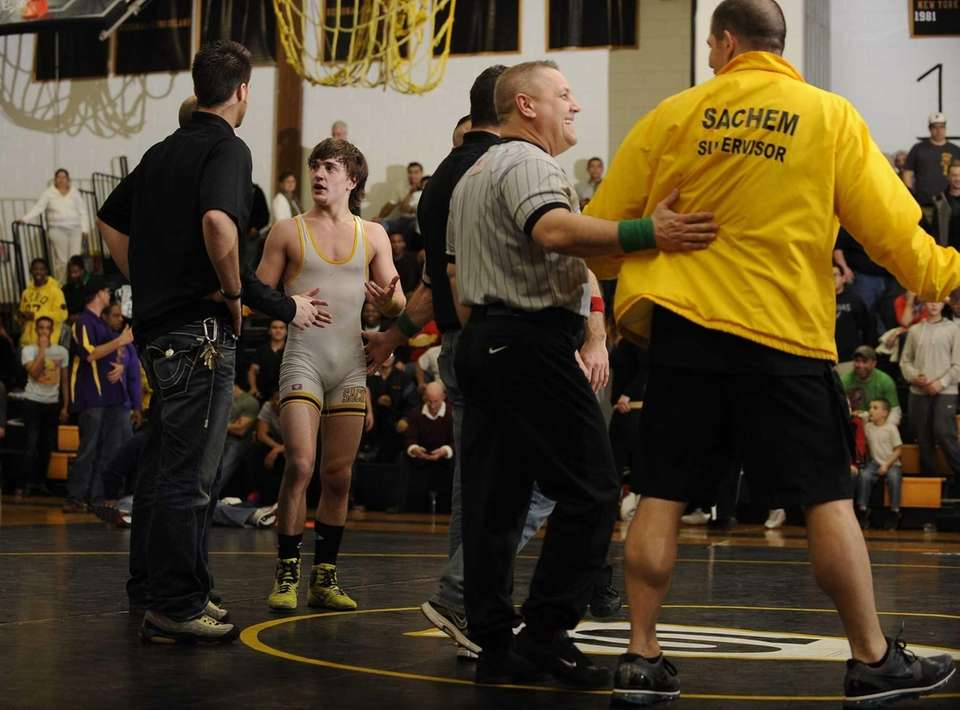 Sachem North's Sean O'Hagan stands and waits on