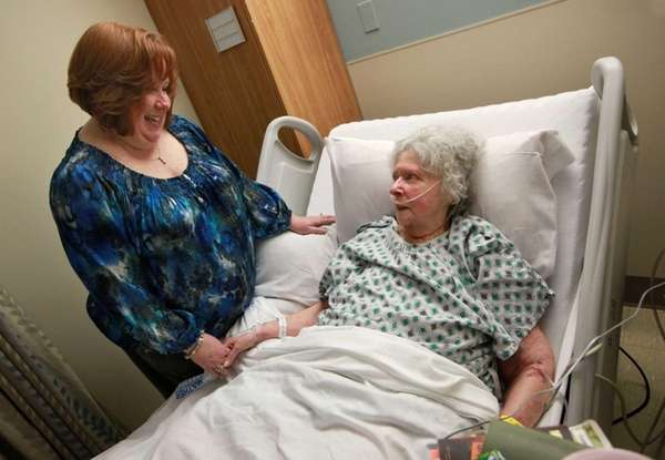 (L-R) Patti Conners visits her mother, Mildred McMahon,