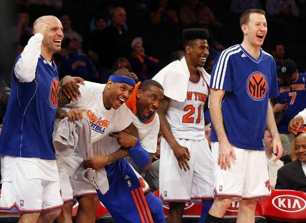 From left, Jason Kidd #5, Carmelo Anthony #7, Amar'e Stoudemire #1, Iman Shumpert #21 and Steve Novak #16 celebrate from the bench late in the game against the <a href=