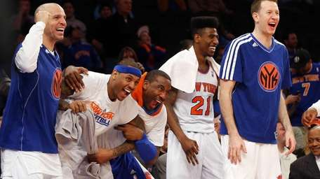 From left, Jason Kidd #5, Carmelo Anthony #7,
