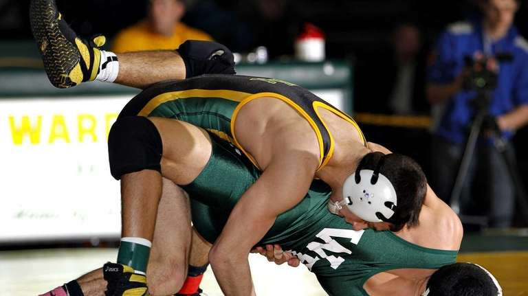 Ward Melville's Nick Piccininni turns William Floyd's Mat
