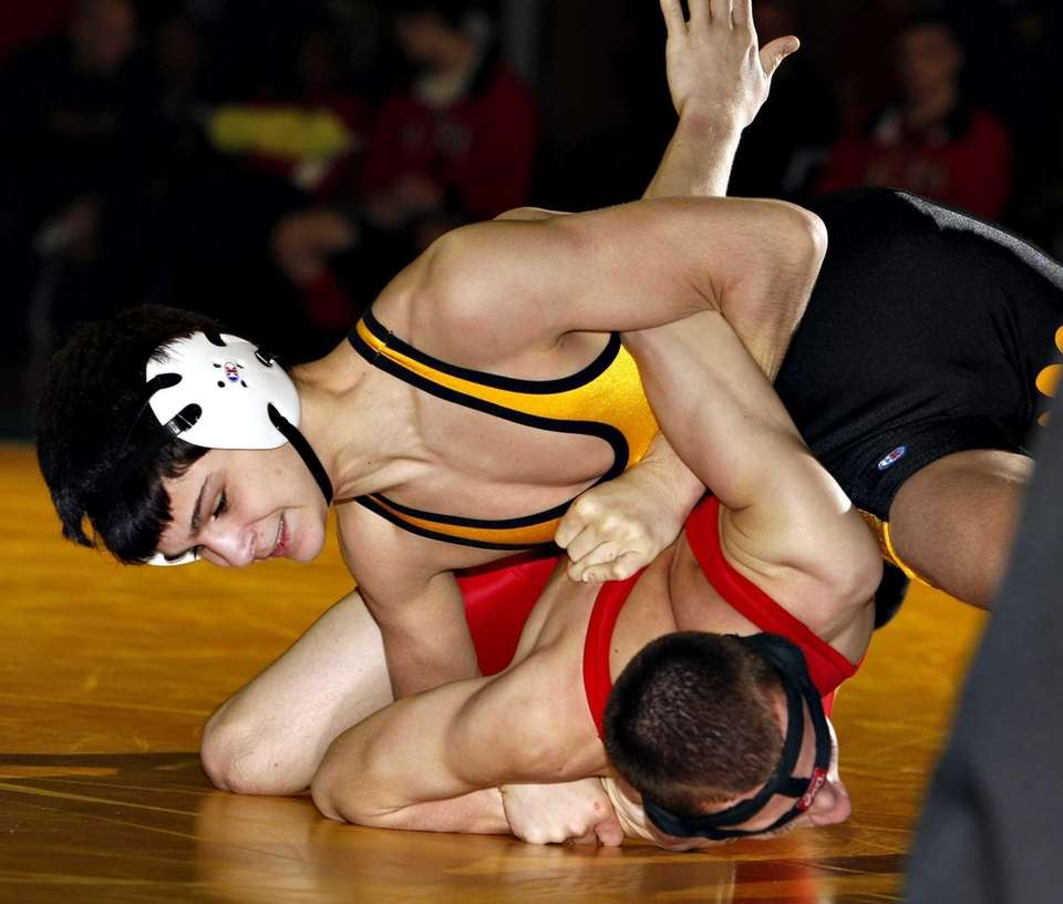 Commack's Mike Dangelo uses an arm bar to