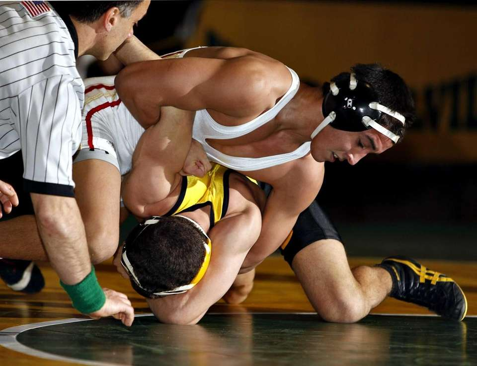 Sachem East's Jacob Restrepo controls Commack's CJ Labate